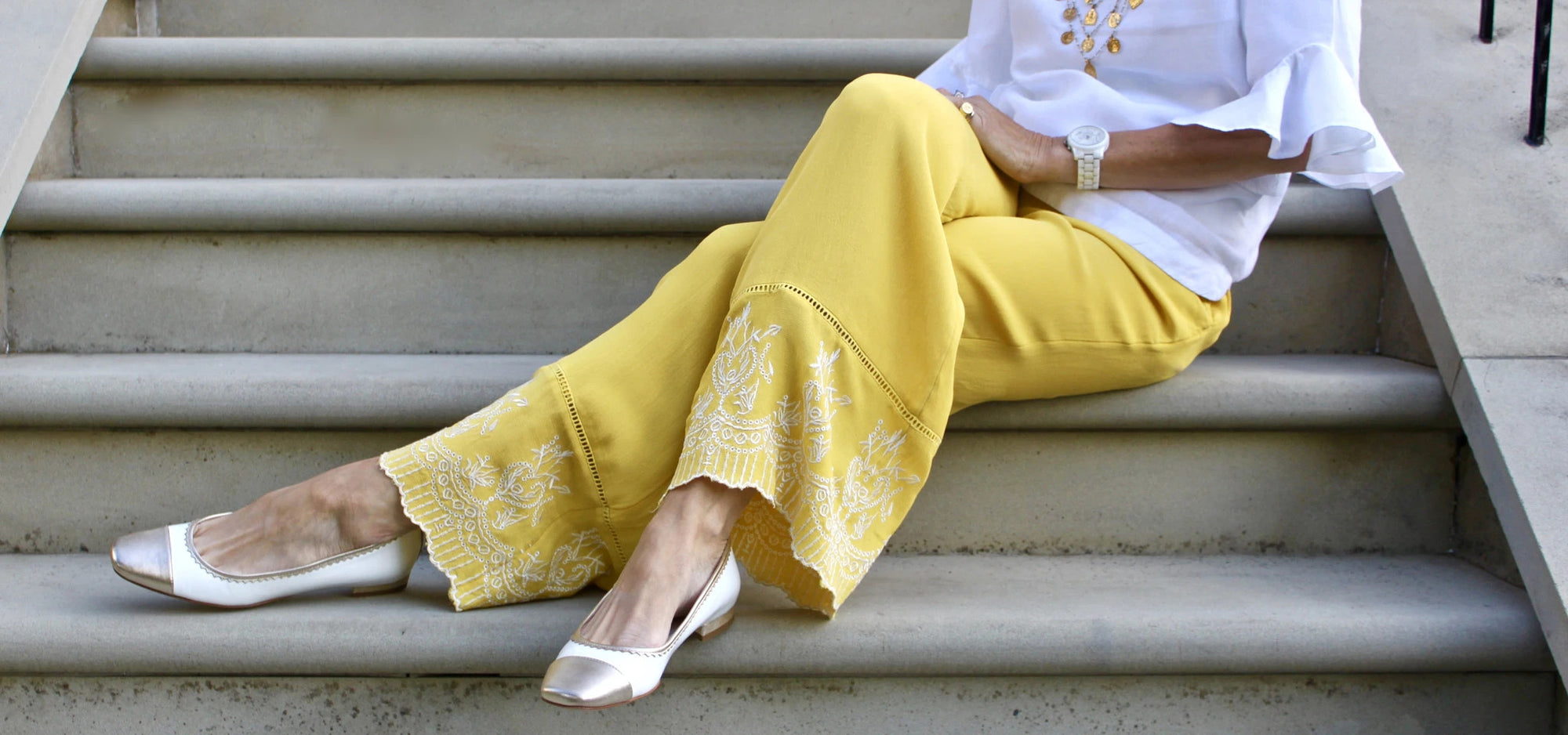 White and gold pumps with half inch heel give comfort and elegance.