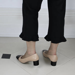 Beige and black two tone leather court shoe with black low heel.