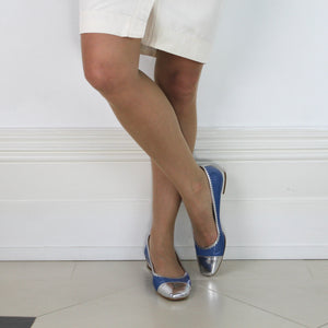 "Blue patent leather pump with silver toe and trim; low 1/2"" heel."