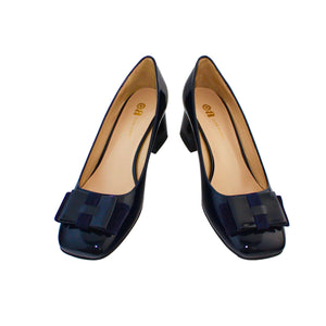 Navy patent court shoe with square toe and flat folded patent and suede bow