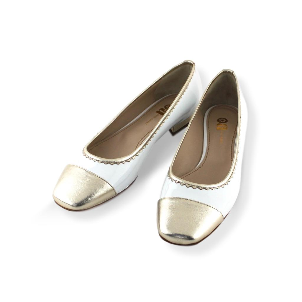 White patent leather pump with gold leather trim and 1/2 inch low heel