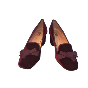 "Red velvet court shoe with matching grosgrain blow and low 2""  velvet covered heel."