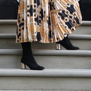 Black grosgrain long length fitted ankle boot with gold heel.