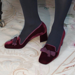 "Red velvet court shoe with matching grosgrain bow and low 2"" velvet covered heel."