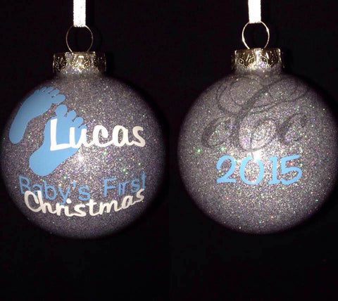 Glass or Acrylic christmas Ornament round with silver glitter with vinyl blue infant feet and name and Baby's First Christmas