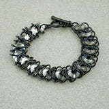Ringer - Silver & Black Chainmaille Bracelet with Glass Rings