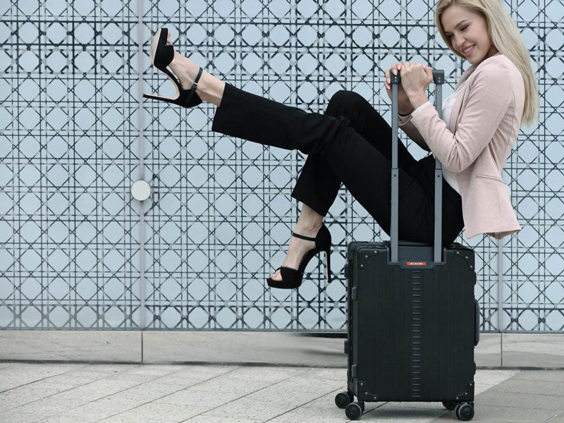Women on aluminum rolled briefcase