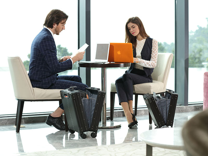 2 people with computers and Aluminum Briefcases