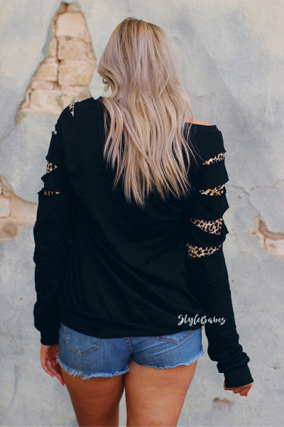 Wild About You Distressed Leopard Sleeve Top- Black