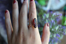 Size 7.5;  Ruby Aura Starfish Space Ring