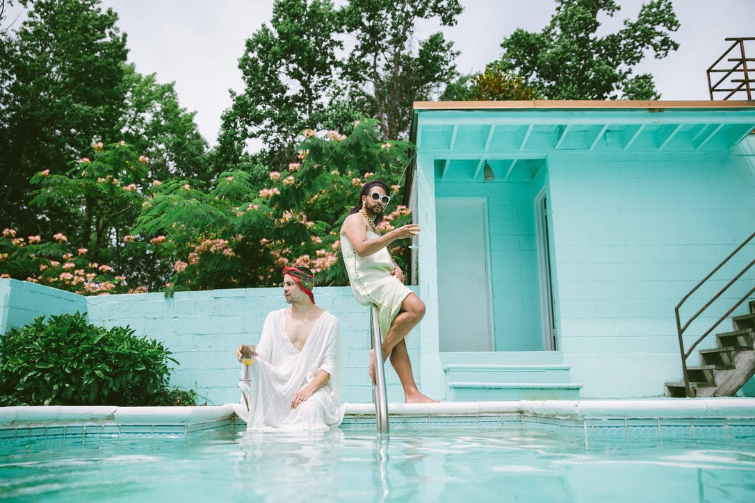 slim aarons-inspired poolside photoshoot with lgbtqia models for pride 2020 | grey gardens vibe