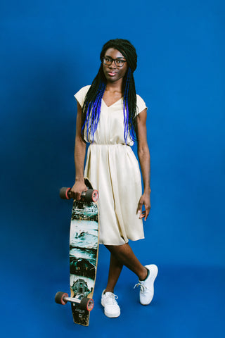 Maacah Davis poses with her skateboard for basic. Black HERstory.