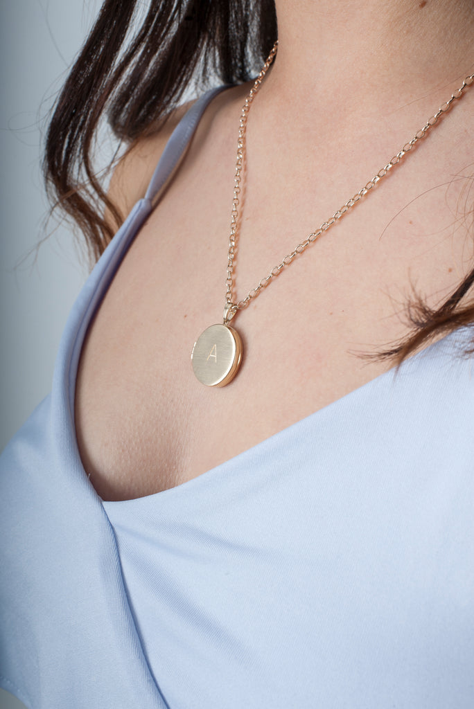 Locket customised in gold for bride jewellery on belcher chain
