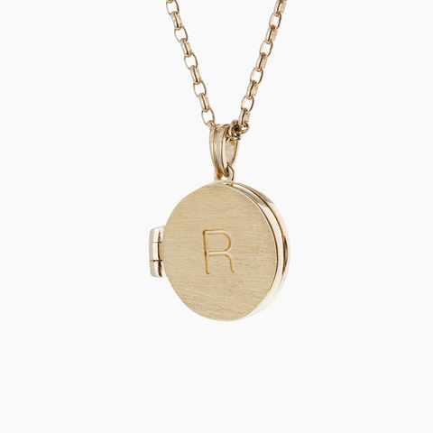 Petite yellow gold locket with custom engraving and belcher chain