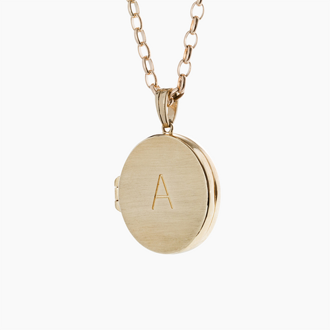Yellow gold locket with personalised engraving