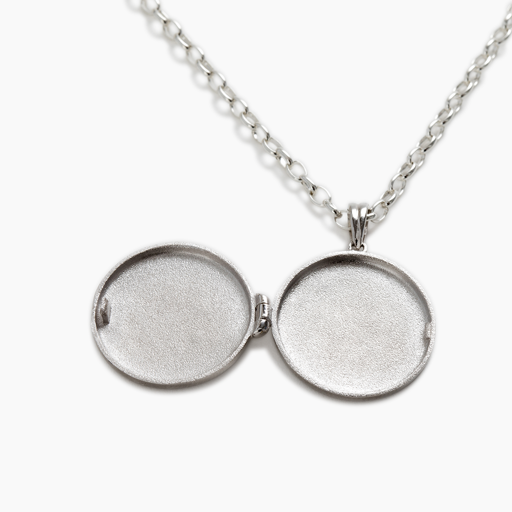 Quality silver locket with hand engraved letters made in NZ
