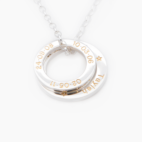 Two sterling silver loops personalised with gold fill engraving on a LoveLoops necklace