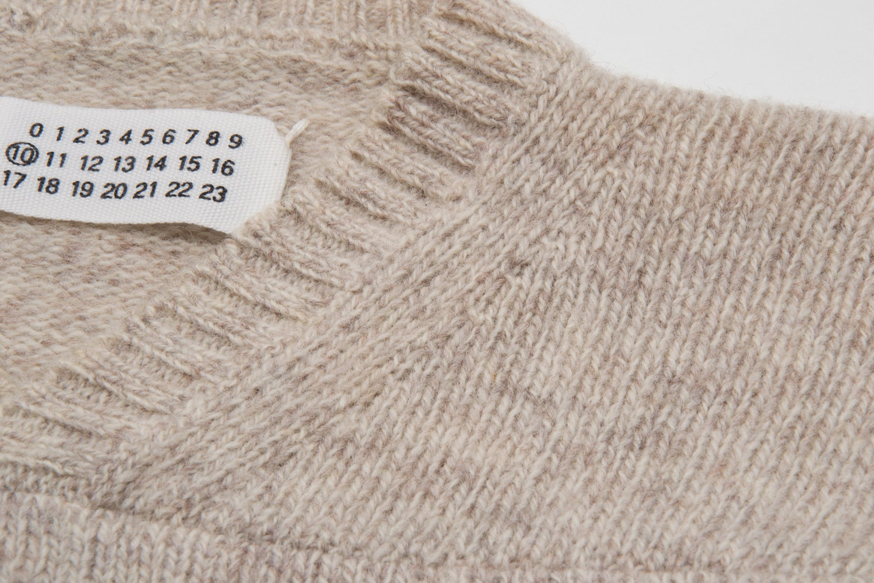 1999 A/W OATMEAL V-NECK SWEATER WITH FRONT SEAMING DETAIL BY MISS DEANNA