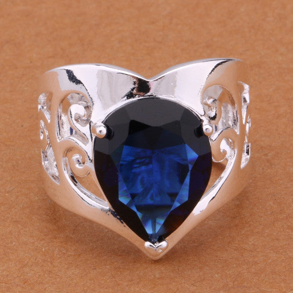 Deep Blue Teardrop Gemstone on wide Silver filagree band