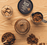 Black Sugar Perfect Essential Scrub 2X. A mask & scrub in one made with black sugar, rice wine, and fruit extracts to buff away dead skin cells for a smooth and bright complexion.