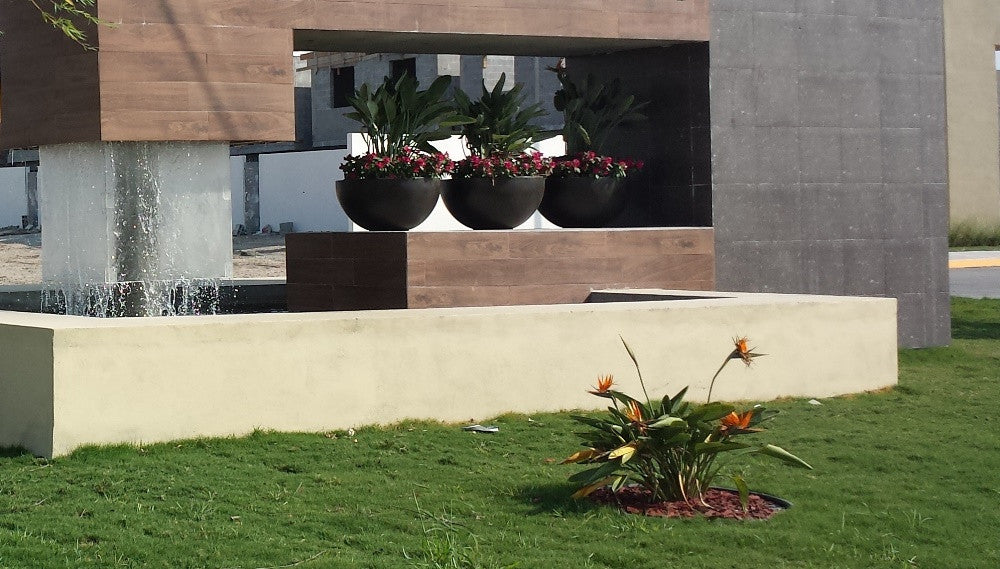 Round planters for beautifying buildings