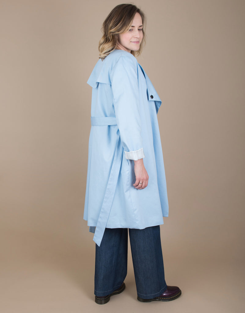 Small batch casual chic clothing sustainably handmade for every woman. Sky Blue Trench Coat.