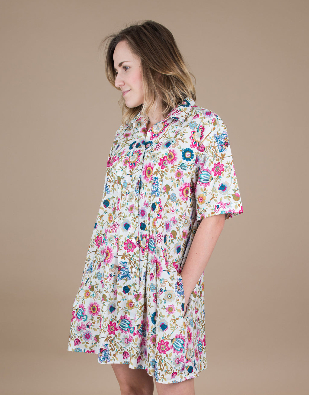 Small batch casual chic clothing sustainably handmade for every woman. Pink Floral Shirt Dress.