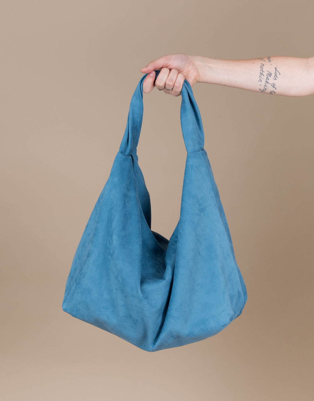 Small batch casual chic clothing sustainably handmade for every woman. Blue Faux Suede Hobo Bag