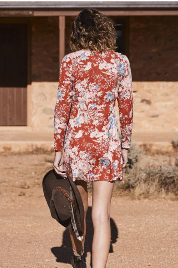 The Alice Sleeved Play Dress in Red with a vintage-inspired signature Floral Print, a baby doll shape that is relaxed around the hips and waist, long sleeves. and a button down front.