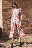 The Alice Day Dress in a Red vintage-inspired floral print, this has a button up front and festival-friendly midi hem length. Fitted across the chest and relaxed across the hips and waist, to create a baby-doll shape with short sleeves.