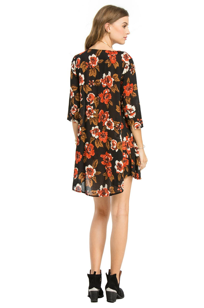 Back view of Amuse Society Casyn Dress is a viscose dress with 3/4 sleeves, a beautiful floral design and stunning neckline in the Black Sands colouring (black, sand and orange/brown)