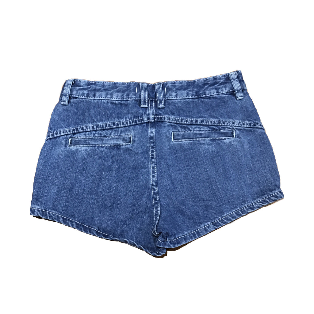 Cropped Free People shorts.  A dark blue denim, with mid rise and white lace ribbon inserts on the front pockets.