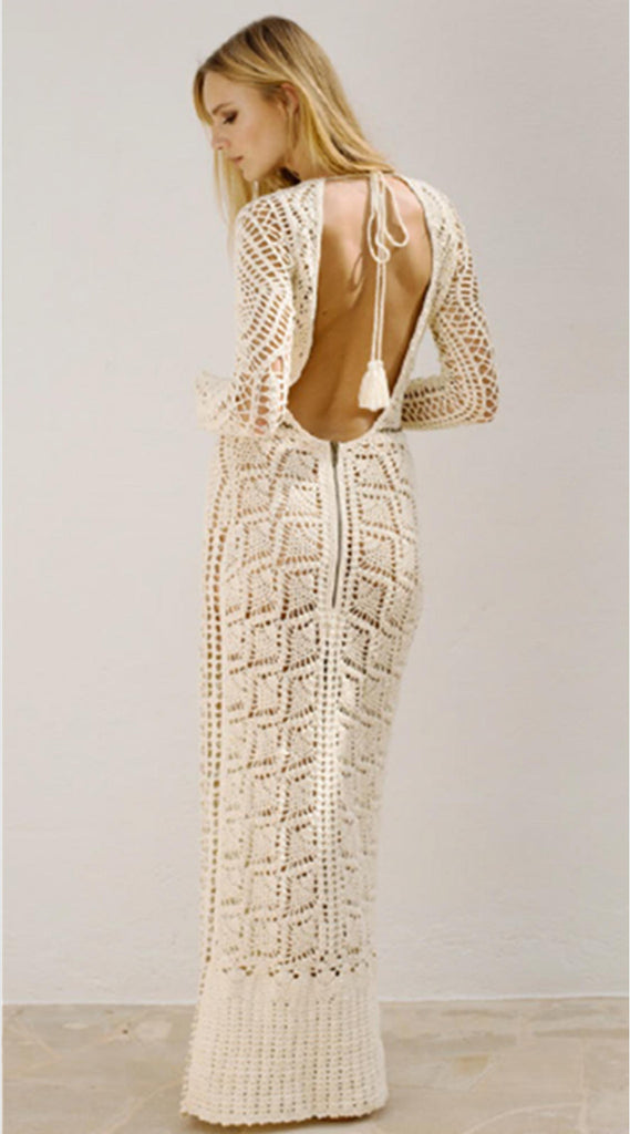 Flook vanilla colour maxi dress. It is completely hand crocheted with chain detail and tassels for that element of luxe. It has a low back with a full length sleeve.
