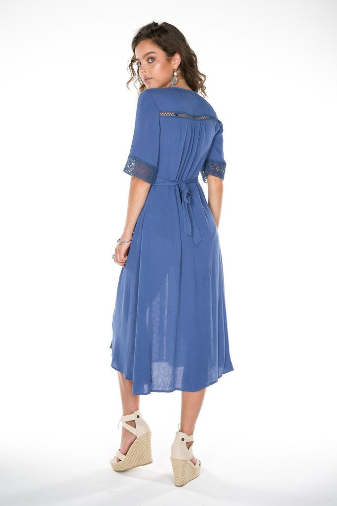 Back Profile of the Eclipse Midi Dress in Aegean Blue; with intricate cotton lace panelling. This elegant button-down dress can also be worn unbuttoned as an incredible duster!