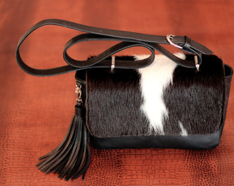 COWHIDE BAG in Black White Hide Hair. Black Leather Bag in Calf Hair on Hide w/ Leather Tassels. Princess Kate Bag