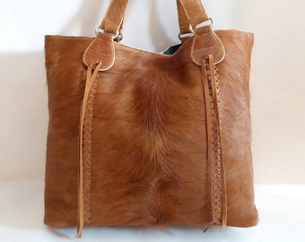 Cowhide Leather Bag in Tan Calf hair. Handmade in Bali.  Steven Bag