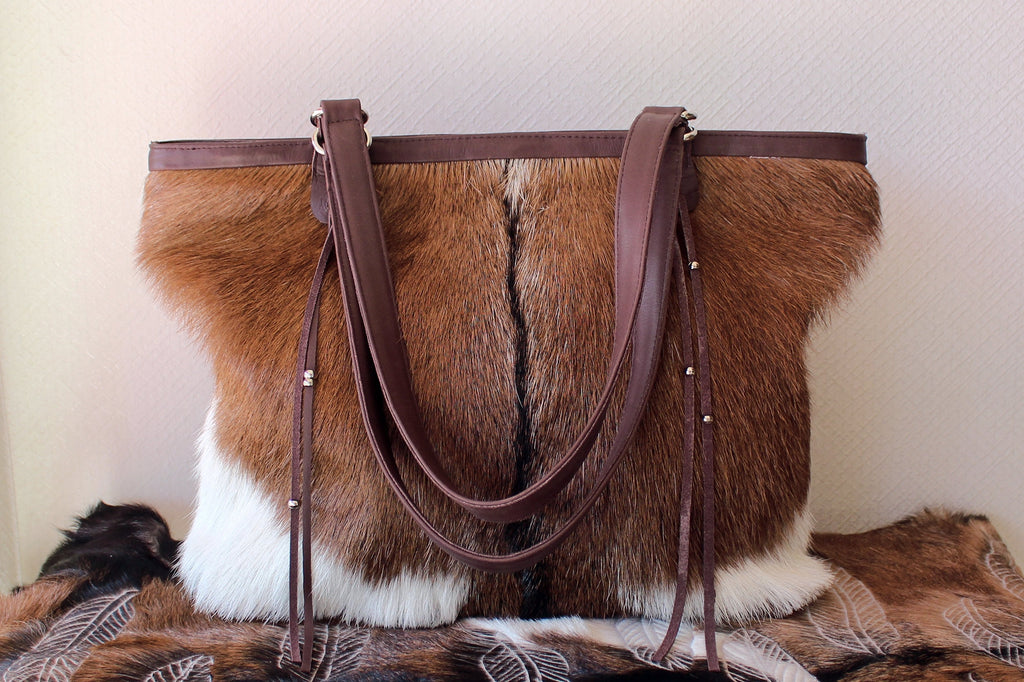 BROWN WHITE COWHIDE TOTE BAG