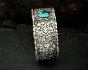 Fabulous Nepali Turquoise Repoussee Bracelet with Eight Auspicious Symbols
