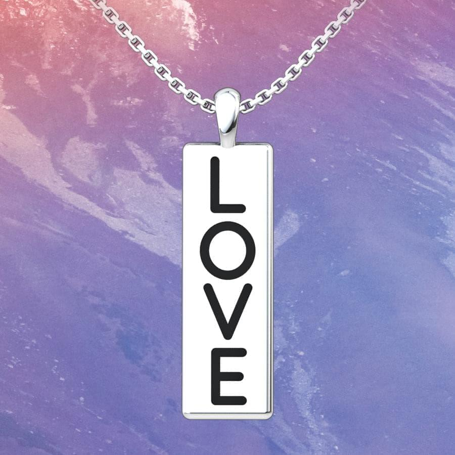 Love Conquers All Sterling Silver Pendant with an 18 inch with a marble background