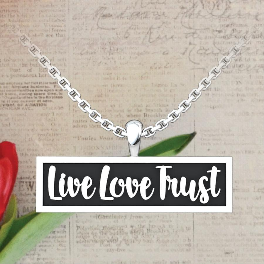Live Love Trust Sterling Silver Pendant on a newspaper background