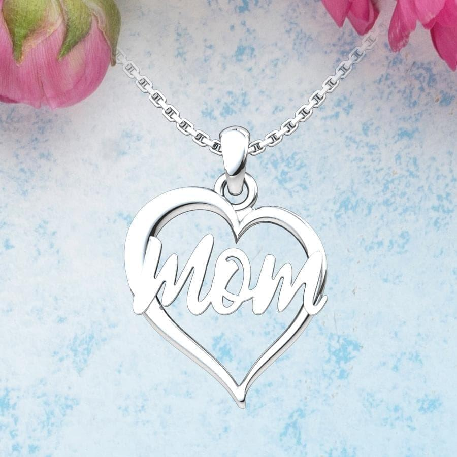 Mom Heart Sterling Silver Pendant on a blue background with flowers