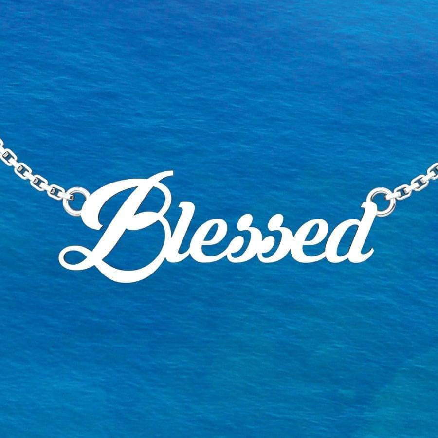 Blessed Sterling Silver pendent in an 18 inch chain with ocean background
