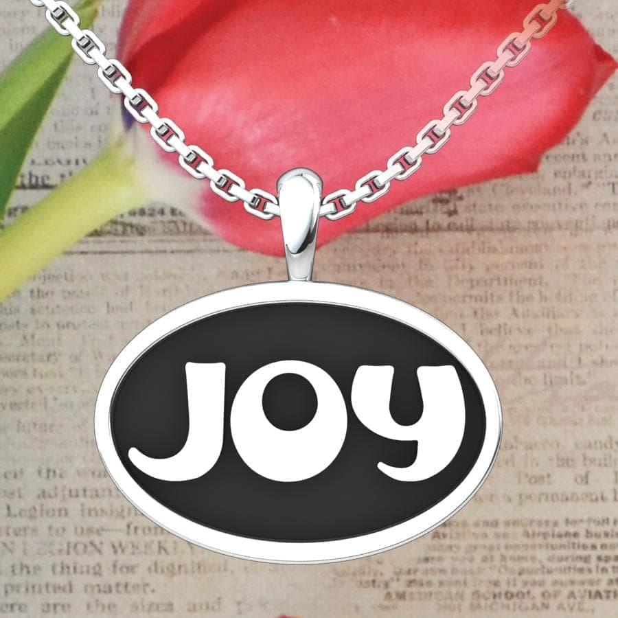 Joy Sterling Silver Pendant with a newspaper and rose background