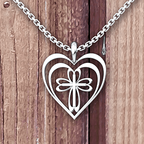 Radiant Heart with Cross Sterling Silver Necklace on a 18 chain with wood background