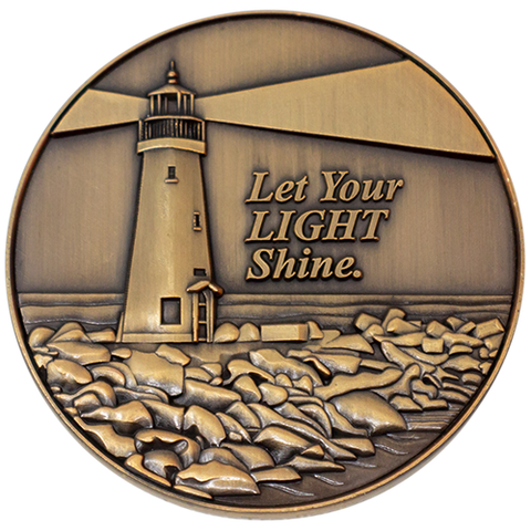 "Front: Lighthouse on the coast, with text, ""Let your light shine."""
