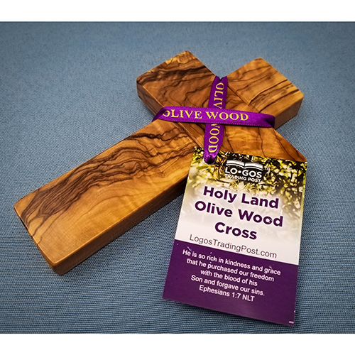 "6.5"" Olive Wood Wall Cross is seen with a beautiful purple ribbon engraved with gold lettering"