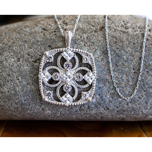 "April Cubic Zirconia Antique Birthstone Cross Pendant - with 18"" Sterling Silver Chain on stone"