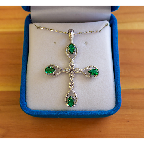 "This Antique Emerald May Birthstone Cross Pendant with an 18"" sterling silver chain with a spring-ring clasp and is packaged in a luxurious plush velvet box."