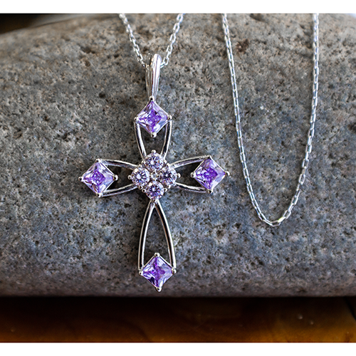 "June Alexandrite Antique Birthstone Cross Pendant - With 18"" Sterling Silver Chain on a stone"
