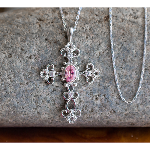 This stunning Antique Pink Tourmaline October Birthstone Cross Pendant merges the old with the new in a modern take on antique styling.